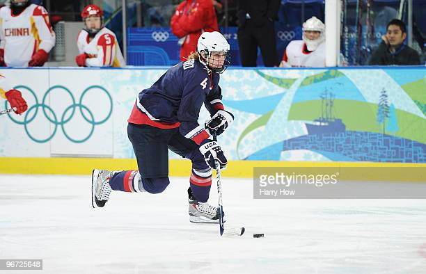 Angela Ruggiero of United States controls the puck on her way to scoring a goal against China during their women's ice hockey preliminary game at UBC...