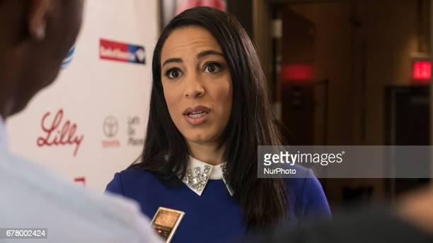 Angela Rye CEO of Impact Strategies political commentator and analyst for CNN and NPR on the red carpet for The State of Black America town hall...