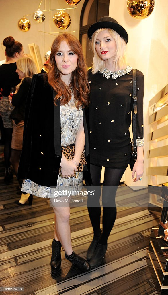 Angela Scanlon (L) and Sophie Sumner attend a Christmas drinks hosted by designer Nicholas Kirkwood to celebrate his partnership with Chambord black raspberry liquer, and launch the limited edition shoe 'The Chambord' at the Nicholas Kirkwood Mount Street store on December 12, 2012 in London, England.