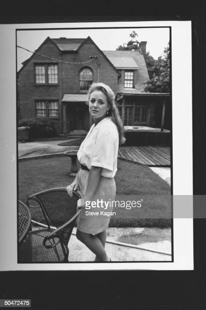 Angela Shoemaker Wallace exwife of AL State Treasurer George Wallace Jr leaning on chair while standing outside her father's home
