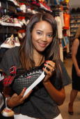 Angela Simmons poses with a Pastry sneaker during her visit to Foot Locker Herald Square on July 7 2009 in New York City