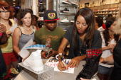 Angela Simmons signs fans autographs during her visit to Foot Locker Herald Square on July 7 2009 in New York City