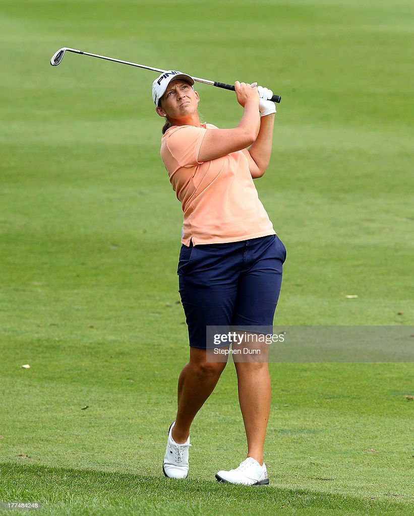 <a gi-track='captionPersonalityLinkClicked' href=/galleries/search?phrase=Angela+Stanford&family=editorial&specificpeople=220267 ng-click='$event.stopPropagation()'>Angela Stanford</a> hits her third shot on the 14th hole during the second round of the CN Canadian Women's Open at Royal Mayfair Golf Club on August 23, 2013 in Edmonton, Alberta, Canada.