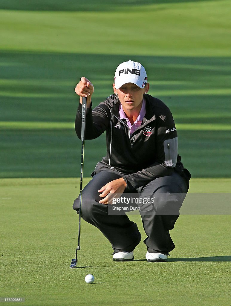 Angela Stanford lines up a putt on the fifth hole during the CN Canadian Women's Open at Royal Mafair Golf Club on August 22, 2013 in Edmonton, Alberta, Canada.