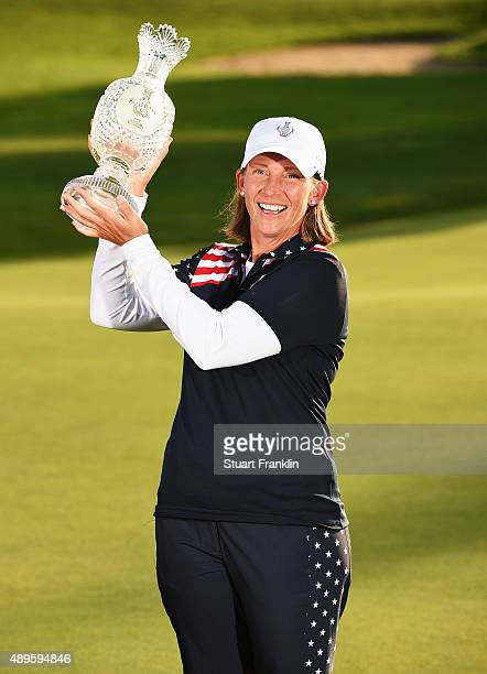 Angela Stanford of team USA holds the Solheim Cup trophy after the final day of The Solheim Cup at St LeonRot Golf Club on September 20 2015 in St...