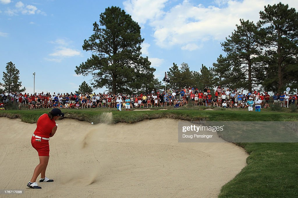 Angela Stanford of the United States Team hits her third shot from the bunker on the 13th hole as she and teammate Gerina Piller of the United States Team where defeated by one hole by Carlota Ciganda of Spain and Azahara Munoz of Spain and the European Team during the afternoon four-ball matches at the 2013 Solheim Cup on August 17, 2013 at the Colorado Golf Club in Parker, Colorado.