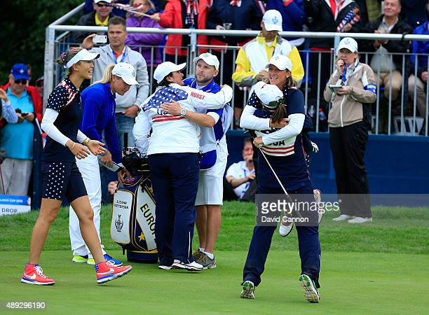Angela Stanford of the United States team is lifted in the air after her win against Suzann Pettersen as Michelle Wie moves in from the left to join...