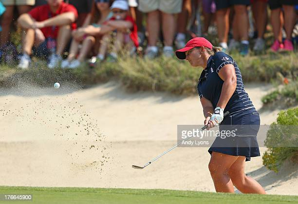 Angela Stanford of the USA Solheim Cup Team hits her third shot on the 14th hole during the friday foursomes matches at 2013 Solheim Cup at the...