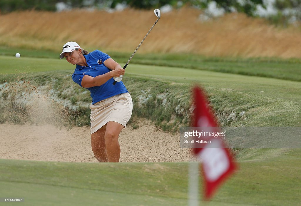 Angela Stanford plays a bunker shot on the 18th hole during the final round of the 2013 U.S. Women's Open at Sebonack Golf Club on June 30, 2013 in Southampton, New York.