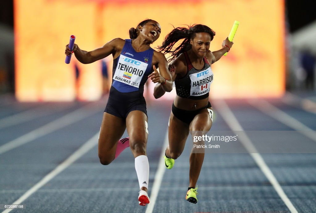Angela Tenorio of Ecuador and Shaina Harrison of Canada cross the finishline in the Women's 4x100 Metres Relay B Final during the IAAF/BTC World Relays Bahamas 2017 at Thomas Robinson Stadium on April 23, 2017 in Nassau, Bahamas.