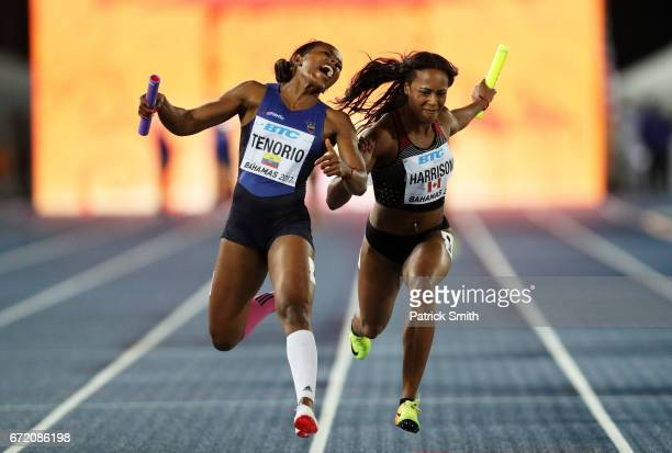 Angela Tenorio of Ecuador and Shaina Harrison of Canada cross the finishline in the Women's 4x100 Metres Relay B Final during the IAAF/BTC World...