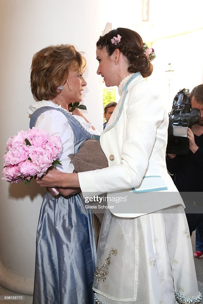 Angela Wepper, mother of Sophie and bride Sophie Wepper during the wedding of Sophie Wepper and David Meister outside the registry office at Mandlstrasse on May 4, 2016 in Munich, Germany.