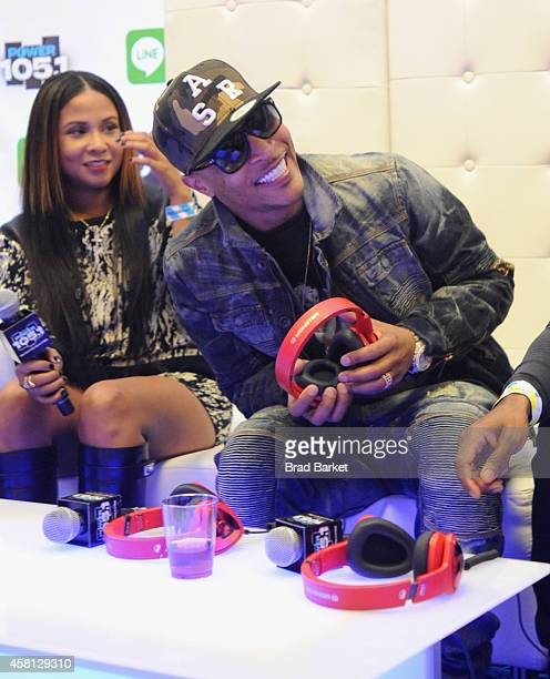 Angela Yee and TI speak backstage at Power 1051's Powerhouse 2014 at Barclays Center of Brooklyn on October 30 2014 in New York City