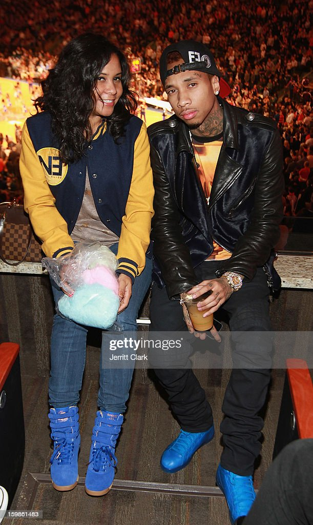 Angela Yee and Tyga visit the Reebok Suite during the Brooklyn Nets vs. New York Knicks game at Madison Square Garden on January 21, 2013 in New York City.