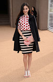 Angelababy arrives at Burberry Womenswear Autumn/Winter 2014 at Kensington Gardens on February 17 2014 in London England