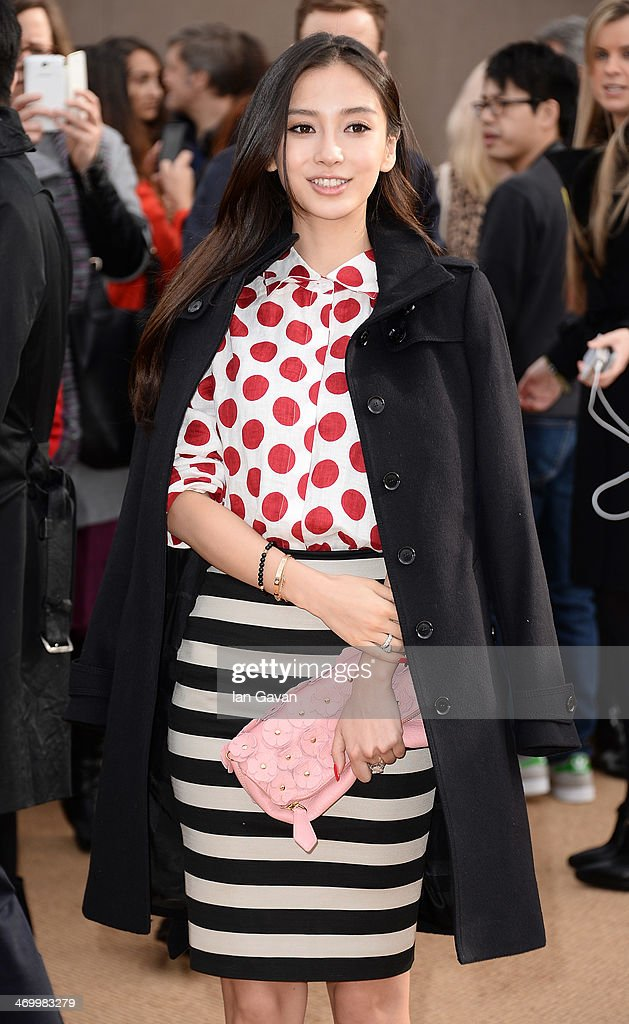 Angelababy arrives at Burberry Womenswear Autumn/Winter 2014 at Kensington Gardens on February 17, 2014 in London, England.