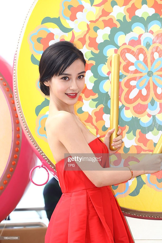 Angelababy attend Spring Festival activities in red dress on Wednesday January 31,2013 in Hong Kong,China.