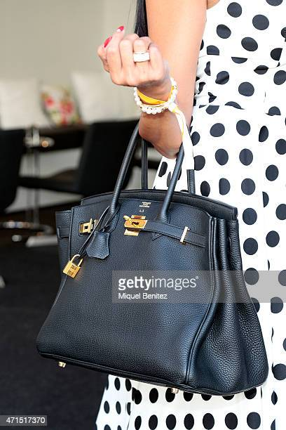 Angeles bag detail wears Tiffany sunglasses BCBG jacket EtxartPanno dress Casa Dei shoes Birkin Hermes handbag and a Rolex Golden Rose during the...