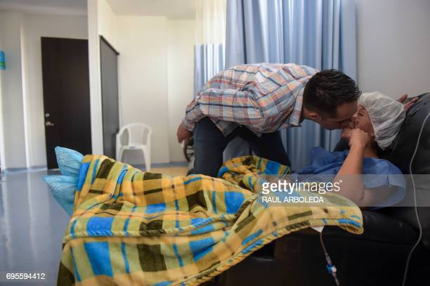 Angeles Borda a 32yearold acid attack survivor kisses her husband Juan Piedrahita prior to her surgery with Dr Alan Gonzalez in Bogota Colombia on...