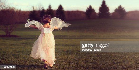 Angelic Fairy Running at Sunset
