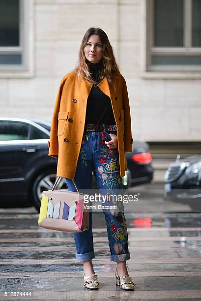 Angelica Ardasheva poses wearing Glamorous pants Gucci shoes and Manurina bag before the Salvatore Ferragamo show during the Milan Fashion Week...