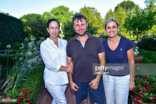 Angelica Basile Giangi Basile and Jacqueline Kleinmen attend ARF in the Garden of Peter Marino at a Private Residence on July 15 2017 in Southampton...