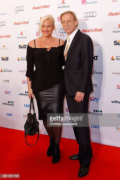 Angelica Camm and Christoph Daum attend the Deutscher Sportjournalistenpreis 2015 at Grand Elysee Hotel on October 5 2015 in Hamburg Germany