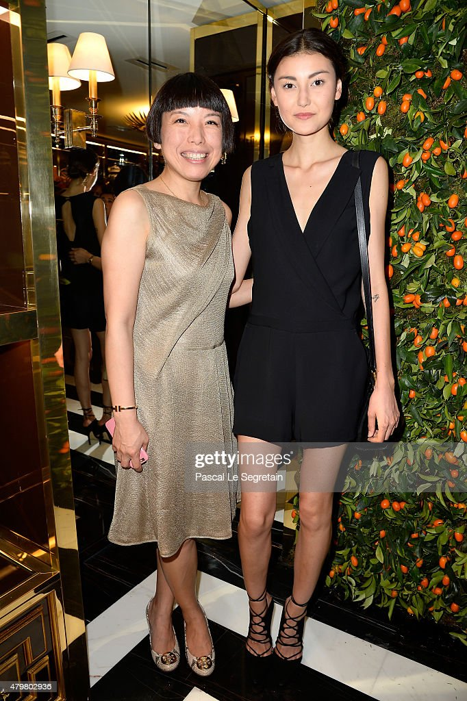 Angelica Cheung and Amalie Gassmann attend the Tory Burch Paris Flagship store opening on July 7 2015 in Paris France