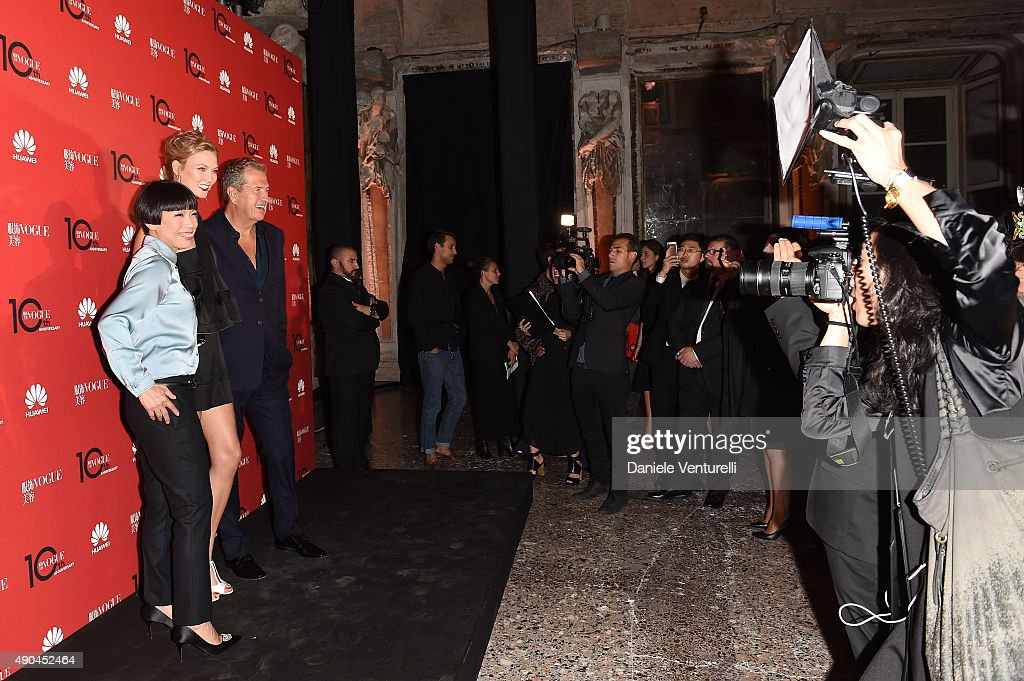 Angelica Cheung Karlie Kloss and Mario Testino attends Vogue China 10th Anniversary at Palazzo Reale on September 28 2015 in Milan Italy