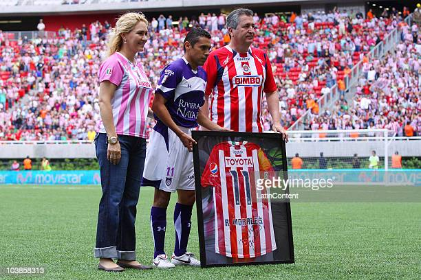 Angelica Fuentes Ramon Morales of Estudiantes and Jorge Vergara of Chivas during a match as part of the Apertura 2010 at Omnilife Stadium on...
