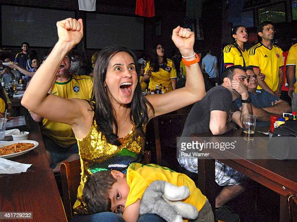 Angelica Halabu and her threeyearold son Eli watch the Colombia vs Brazil World Cup quarterfinal match at a viewing party at the Red Fox English Pub...