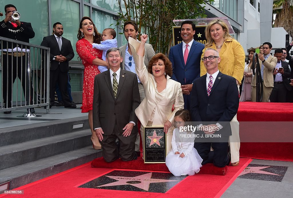 Angelica Maria reacts as her Hollywood Walk of Fame Star is unveiled on May 25, 2016 in Hollywood, California. The actress, affectionately known in Latin America as 'Mexico's Sweetheart', is the recipient of the 2,582nd star on the Walk of Fame in the category of Live Performance/Theater. / AFP / FREDERIC