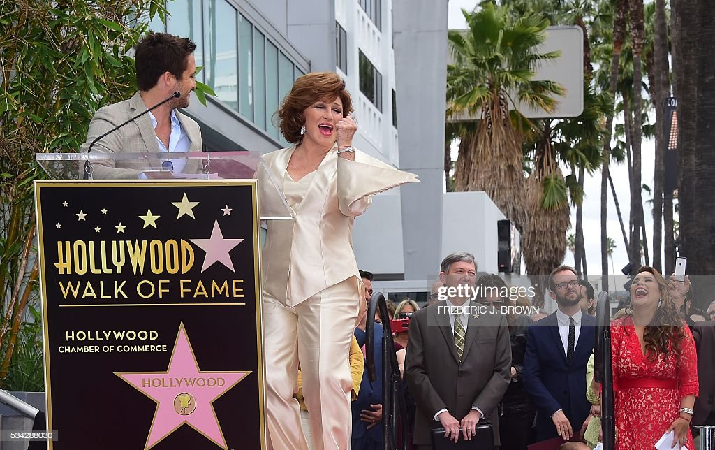 Angelica Maria reacts on stage with beside Diego Boneta during her Hollywood Walk of Fame Star ceremony on May 25, 2016 in Hollywood, California. The actress, affectionately known in Latin America as 'Mexico's Sweetheart', is the recipient of the 2,582nd star on the Walk of Fame in the category of Live Performance/Theater. / AFP / FREDERIC