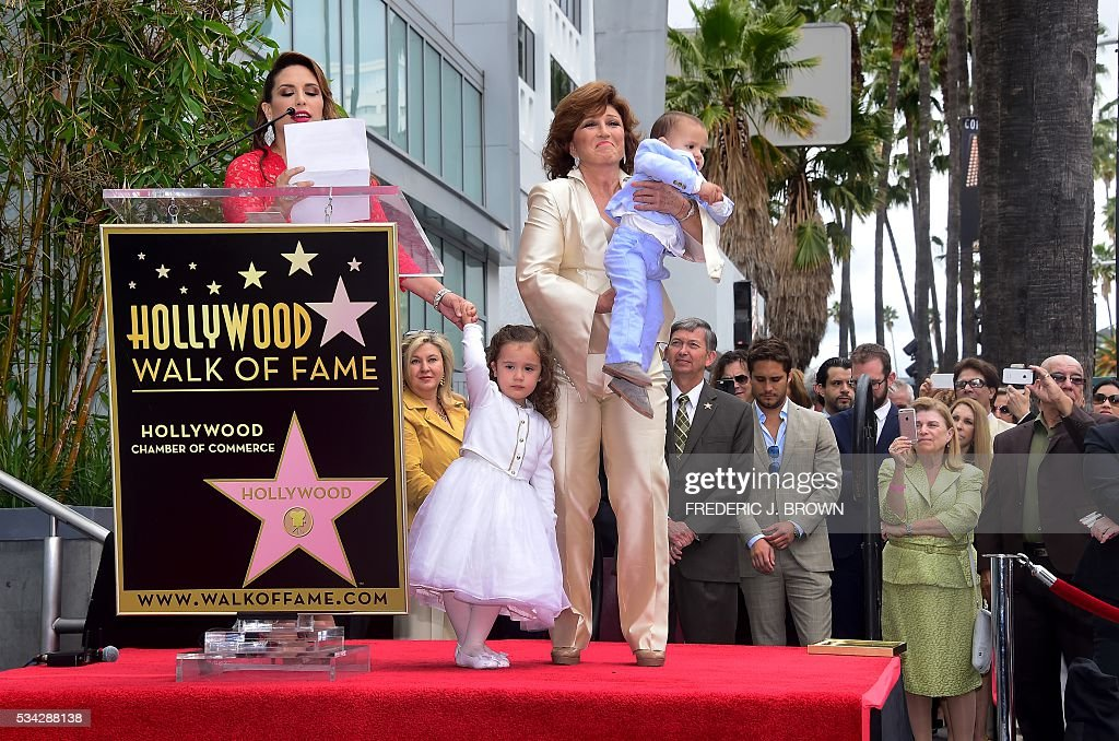 Angelica Maria reacts with her grandchildern on stage as daughter, comedianne Angelica Vale speaks during her mother's Hollywood Walk of Fame Star ceremony on May 25, 2016 in Hollywood, California The actress, affectionately known in Latin America as 'Mexico's Sweetheart', is the recipient of the 2,582nd star on the Walk of Fame in the category of Live Performance/Theater. / AFP / FREDERIC