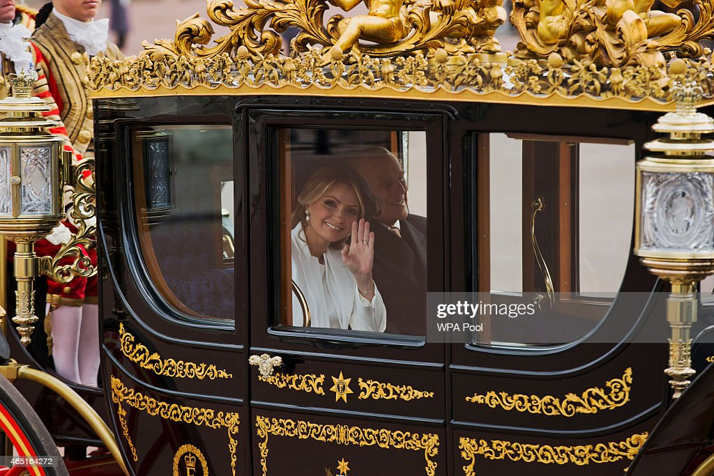 Angelica Rivera, the wife of Mexican President Enrique Pena Nieto, waves at photographers as she and Prince Philip, Duke of Edinburgh arrive in a carriage at Buckingham Palace on March 3, 2015 in London, England. The President of Mexico, accompanied by Senora Angelica Rivera de Pena, are on a State Visit to the United Kingdom as the guests of Her Majesty The Queen from Tuesday 3rd March to Thursday 5th March.