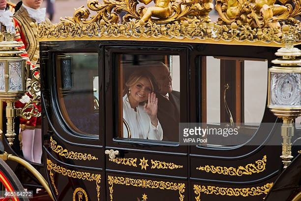 Angelica Rivera the wife of Mexican President Enrique Pena Nieto waves at photographers as she and Prince Philip Duke of Edinburgh arrive in a...
