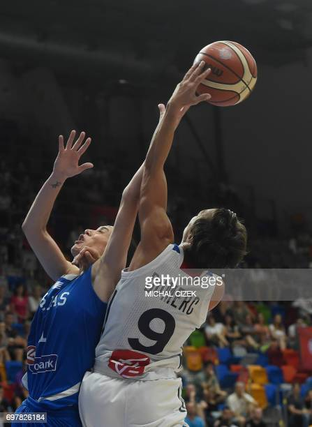 Angeliki Nikolopoulou of Greece tries to block France's Celine Dumerc during the FIBA EuroBasket women's Basketball match France v Greece on June 19...