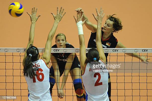 Angelina Grun of Germany smashes as Milena Rasic and Jovana Brakocevic of Serbia block during the women's Volleyball European Championship final...