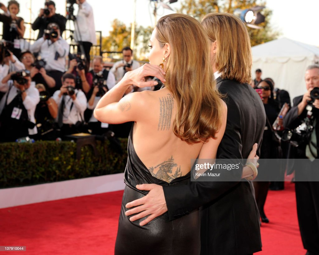 Angelina Jolie and Brad Pitt arrive at The 18th Annual Screen Actors Guild Awards broadcast on TNT/TBS at The Shrine Auditorium on January 29, 2012 in Los Angeles, California. (Photo by Kevin Mazur/WireImage) 22005_007_KM_1067.JPG