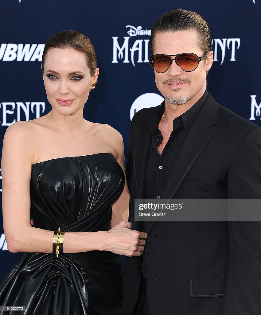 <a gi-track='captionPersonalityLinkClicked' href=/galleries/search?phrase=Angelina+Jolie&family=editorial&specificpeople=201591 ng-click='$event.stopPropagation()'>Angelina Jolie</a> and <a gi-track='captionPersonalityLinkClicked' href=/galleries/search?phrase=Brad+Pitt+-+Actor&family=editorial&specificpeople=201682 ng-click='$event.stopPropagation()'>Brad Pitt</a> arrives at the World Premiere Of Disney's 'Maleficent' at the El Capitan Theatre on May 28, 2014 in Hollywood, California.