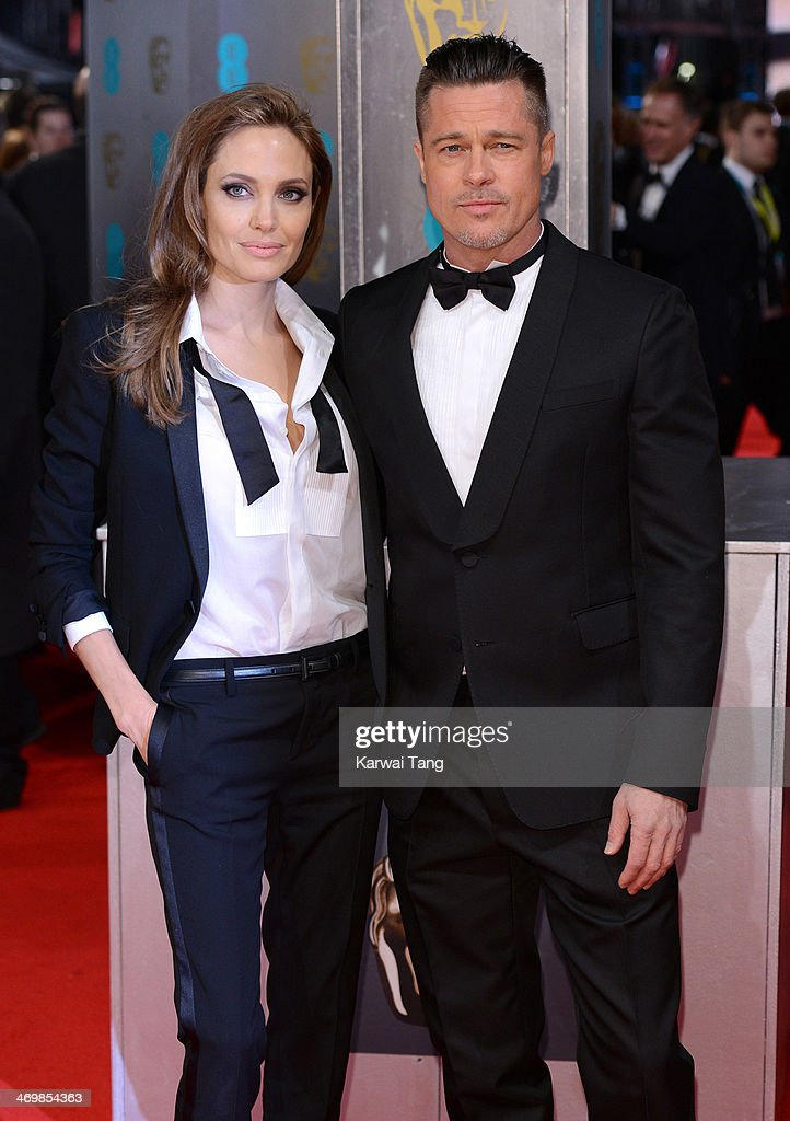 <a gi-track='captionPersonalityLinkClicked' href=/galleries/search?phrase=Angelina+Jolie&family=editorial&specificpeople=201591 ng-click='$event.stopPropagation()'>Angelina Jolie</a> and <a gi-track='captionPersonalityLinkClicked' href=/galleries/search?phrase=Brad+Pitt+-+Actor&family=editorial&specificpeople=201682 ng-click='$event.stopPropagation()'>Brad Pitt</a> attend the EE British Academy Film Awards 2014 at The Royal Opera House on February 16, 2014 in London, England.