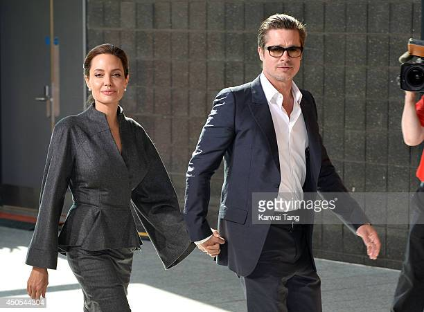 Angelina Jolie and Brad Pitt attend the Global Summit to end Sexual Violence in Conflict at ExCel on June 13 2014 in London England