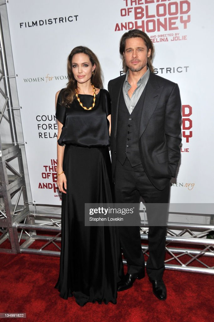 <a gi-track='captionPersonalityLinkClicked' href=/galleries/search?phrase=Angelina+Jolie&family=editorial&specificpeople=201591 ng-click='$event.stopPropagation()'>Angelina Jolie</a> and <a gi-track='captionPersonalityLinkClicked' href=/galleries/search?phrase=Brad+Pitt+-+Actor&family=editorial&specificpeople=201682 ng-click='$event.stopPropagation()'>Brad Pitt</a> attend the premiere of 'In the Land of Blood and Honey' at the School of Visual Arts on December 5, 2011 in New York City.
