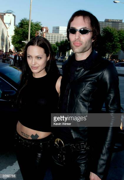 Angelina Jolie and brother James Haven arrive for the premiere of the film 'Lara Croft Tomb Raider' at Mann Village Theatre in Los Angeles CA Monday...