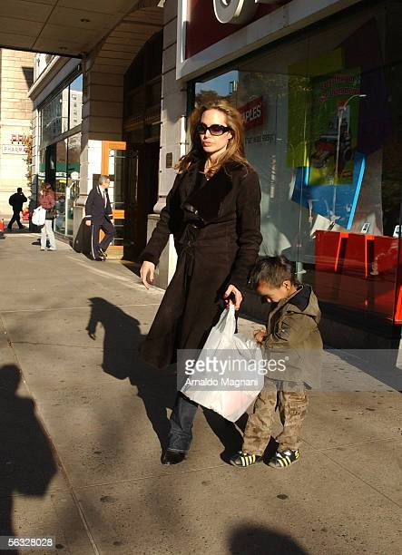 Angelina Jolie and her son Maddox leave the Antique Showroom on 6th Ave after shopping December 3 2005 in New York City