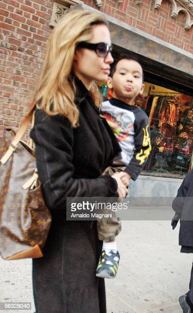 Angelina Jolie and her son Maddox who shows his tongue to photographers leave the Antique Showroom on 6th Ave after shopping December 3 2005 in New...