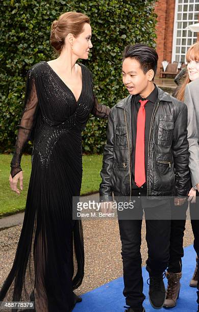 Angelina Jolie and Maddox JoliePitt arrive at a private reception as costumes and props from Disney's 'Maleficent' are exhibited in support of Great...