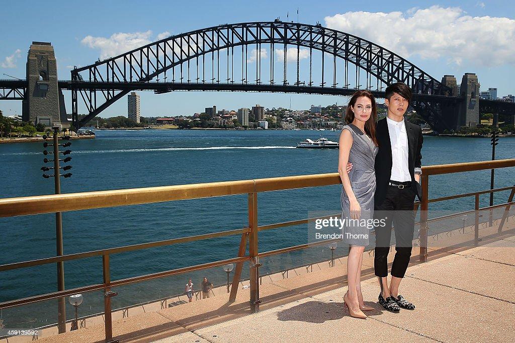 Angelina Jolie and Miyavi Ishihara pose at the photo call of Unbroken at Sydney Opera House on November 18, 2014 in Sydney, Australia.
