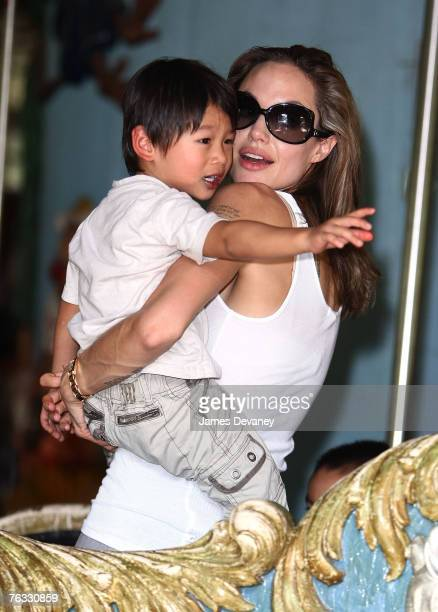 Angelina Jolie and Pax JoliePitt visit the Central Park Carousel in New York City on August 25 2007