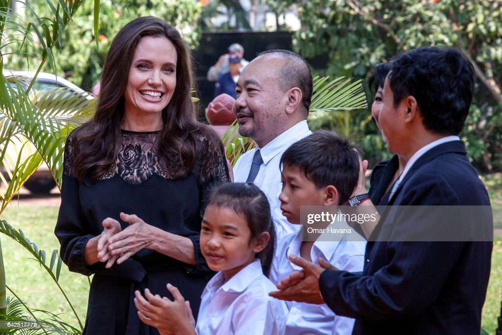 Angelina Jolie (left) and producer Rithy Panh (center) chat with actors before holding a press conference ahead of the premiere of their new film 'First They Killed My Father' set up at the Raffles Grand Hotel D'Angkor on February 18, 2017 in Siem Reap, Cambodia. Angelina Jolie is in Siem Reap for the world premiere of her new movie, 'First They Killed my Father,' a Netflix-produced adaption of the autobiography by the same name penned by Loung Ung, who lived through the Khmer Rouge regime as a young child. The film will be screened Saturday night in the Angkor Wat temple complex, and released later this year on Netflix.
